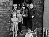 Bob Dylan, Kids on steps, Liverpool, 1966. by BARRY FEINSTEIN